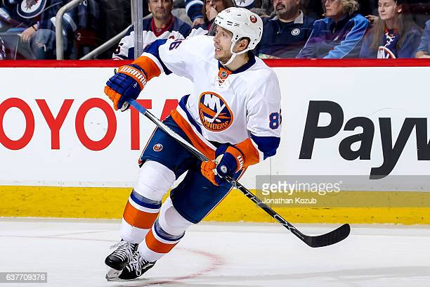 Nikolay Kulemin of the New York Islanders keeps an eye on the play during second period action against the Winnipeg Jets at the MTS Centre on...