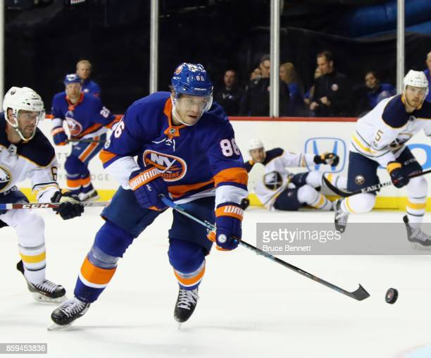Nikolay Kulemin of the New York Islanders skates against the Buffalo Sabres at the Barclays Center on October 7 2017 in the Brooklyn borough of New...