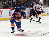 Nikolay Kulemin of the New York Islanders skates against the New Jersey Devils at the Barclays Center on September 26 2014 in the Brooklyn borough of...