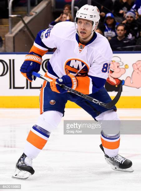 Nikolay Kulemin of the New York Islanders skates against the Toronto Maple Leafs during the second period at the Air Canada Centre on February 14...