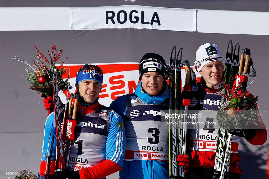 <a gi-track='captionPersonalityLinkClicked' href=/galleries/search?phrase=Nikolay+Morilov&family=editorial&specificpeople=4165561 ng-click='$event.stopPropagation()'>Nikolay Morilov</a> of Russia takes 2nd place, <a gi-track='captionPersonalityLinkClicked' href=/galleries/search?phrase=Dario+Cologna&family=editorial&specificpeople=4779620 ng-click='$event.stopPropagation()'>Dario Cologna</a> of Switzerland takes 1st place, Anders Gloeersen of Norway takes 3rd place during the FIS Cross Country World Cup Men's Sprint on December 18, 2011 in Rogla, Slovenia.