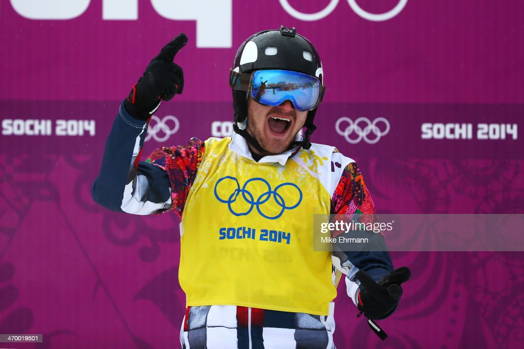 Nikolay Olyunin of Russia celebrates after his heat in the Men's Snowboard Cross Quarterfinals on day eleven of the 2014 Winter Olympics at Rosa Khutor Extreme Park on February 18, 2014 in Sochi, Russia.