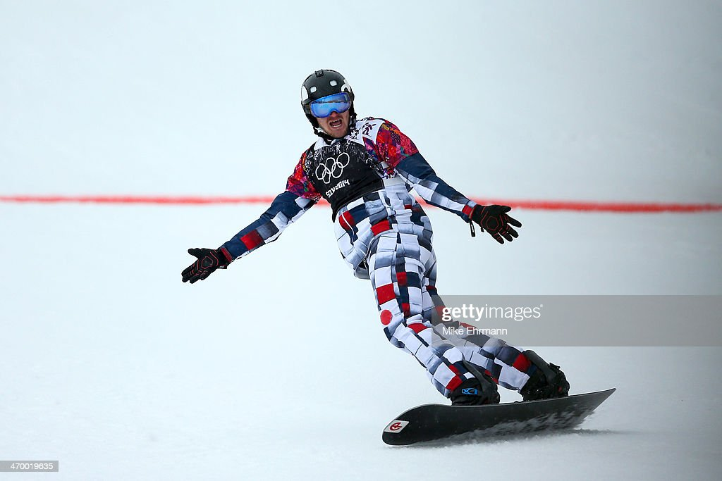 Nikolay Olyunin of Russia celebrates as he crosses the line during his heat in the Men's Snowboard Cross Semifinals on day eleven of the 2014 Winter Olympics at Rosa Khutor Extreme Park on February 18, 2014 in Sochi, Russia.