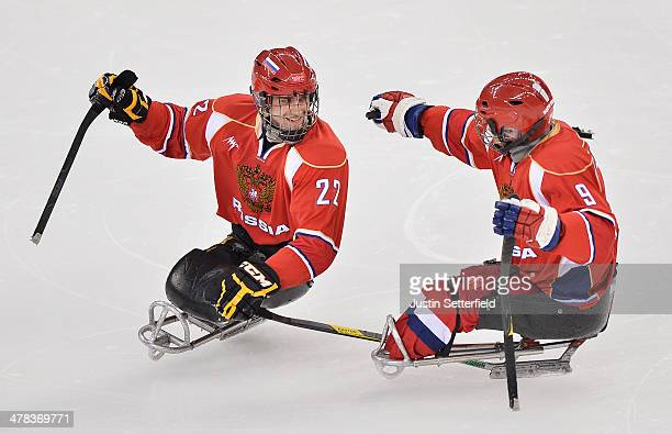 Nikolay Terentyev of Russia celebrates scoring the 3rd goal during the Ice Sledge Hockey play off semifinal match between Russia and Norway at the...