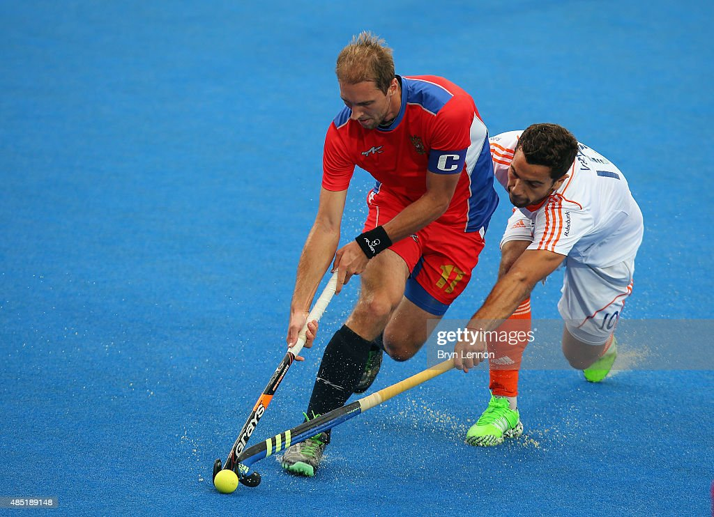 Nikolay Yankun of Russia is tackled by Valentin Verga of The Netherlands during the match between Russia and The Netherlands on day five of the Unibet EuroHockey Championships at Lee Valley Hockey and Tennis Centre on August 25, 2015 in London, England.