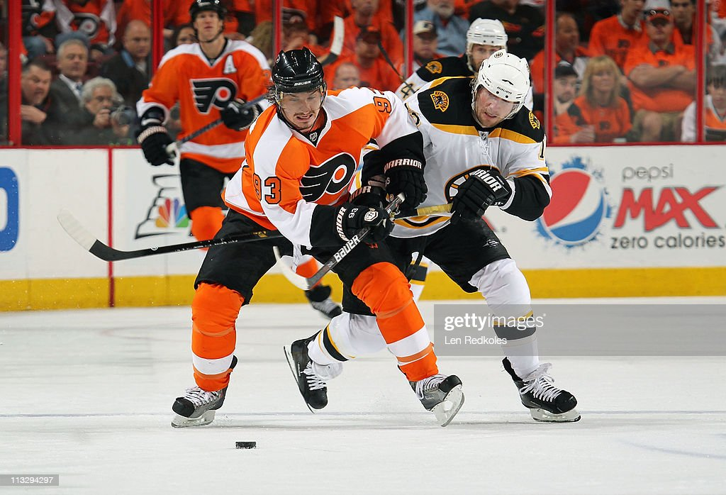 Nikolay Zherdev #93 of the Philadelphia Flyers battles for the puck against Michael Ryder #73 of the Boston Bruins in Game One of the Eastern Conference Semifinals during the 2011 NHL Stanley Cup Playoffs at the Wells Fargo Center on April 30, 2011 in Philadelphia, Pennsylvania.