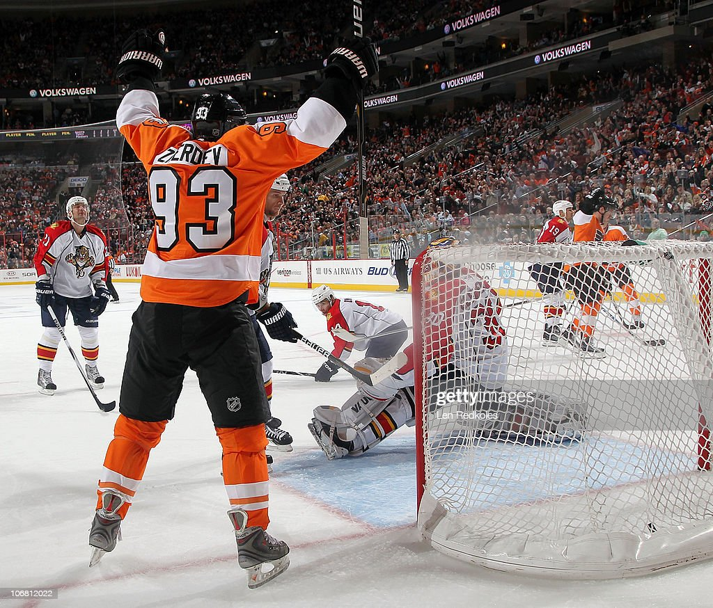 Nikolay Zherdev of the Philadelphia Flyers celebrates a firstperiod goal by teammate Mike Richards against Scott Clemmensen of the Florida Panthers...