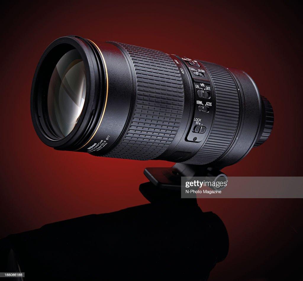A Nikon AF-S 80-400mm f/4.5-5.6G ED VR lens photographed on a red background, on April 15, 2013.
