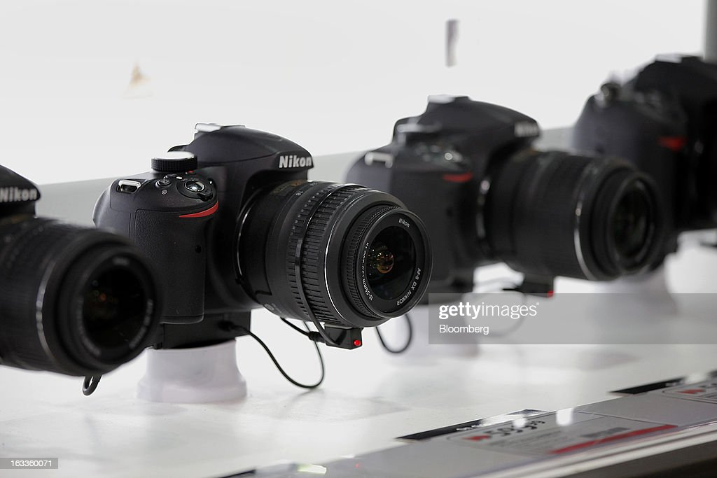 Nikon Corp. cameras are displayed for sale at a Future Shop store in Vancouver, British Columbia, Canada, on Thursday, March 7, 2013. Future Shop, Canada's largest consumer electronics retailer, offers home and entertainment products, including televisions, computers, cameras, MP3 players, video games, computer add-ons, software, and audo and video systems. Photographer: Deddeda White/Bloomberg via Getty Images