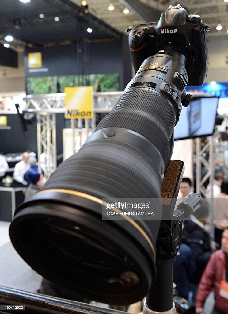 Nikon's new AF-S NIKKOR 800mm f/5.6E FL ED VR lens, attached to a D4 SLR camera (top R) is displayed during the CP+, (CP plus) photo imaging show in Yokohama on January 31, 2013. Around 96 companies are participating in the exhibition with some 70,000 visitors expected in the four-day-long event. AFP PHOTO / TOSHIFUMI KITAMURA