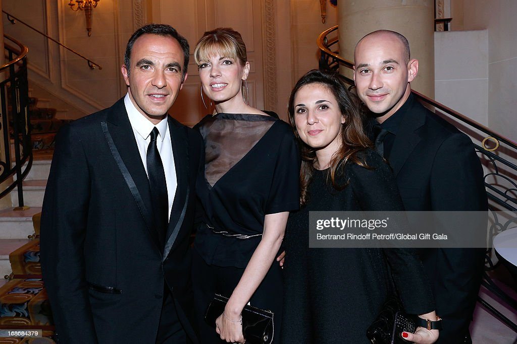 <a gi-track='captionPersonalityLinkClicked' href=/galleries/search?phrase=Nikos+Aliagas&family=editorial&specificpeople=573643 ng-click='$event.stopPropagation()'>Nikos Aliagas</a> and companion Tina Grigoriou, Nikos's sister Maria Aliagas and her companion Marios Argyropoulos. <a gi-track='captionPersonalityLinkClicked' href=/galleries/search?phrase=Nikos+Aliagas&family=editorial&specificpeople=573643 ng-click='$event.stopPropagation()'>Nikos Aliagas</a> has 44 years old today - 'Global Gift Gala' at Hotel George V on May 13, 2013 in Paris, France.