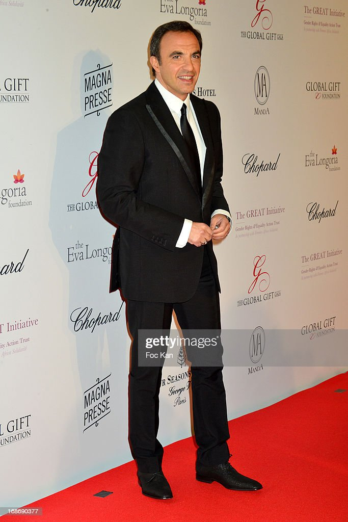 Nikos Aliagas attends the Eva Longoria Presents 'Global Gift Gala' 2013 - Photocall at the Hotel Four Season GeorgesV on May 13, 2013 in Paris, France.