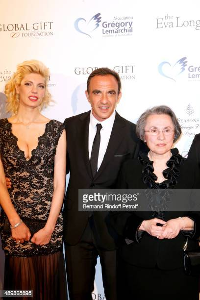Nikos Aliagas his companion Tina Grigoriou and his mother attend the 'Global Gift Gala' 2014 Charity Dinner at the Four Seasons Hotel on May 12 2014...