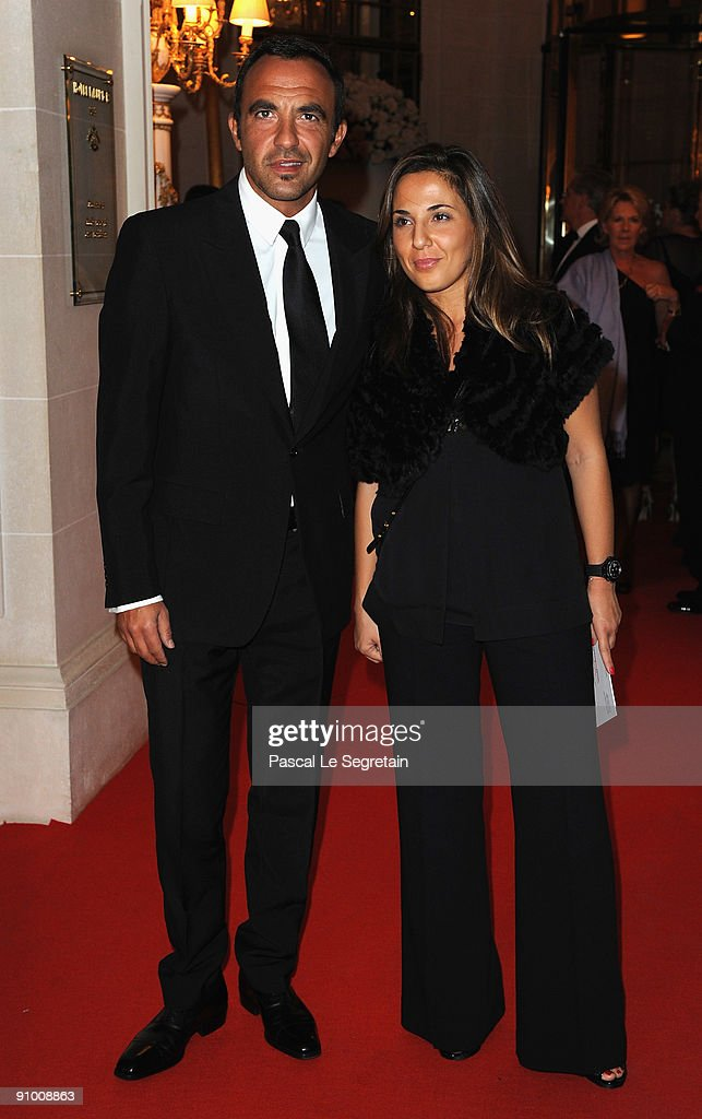 <a gi-track='captionPersonalityLinkClicked' href=/galleries/search?phrase=Nikos+Aliagas&family=editorial&specificpeople=573643 ng-click='$event.stopPropagation()'>Nikos Aliagas</a> poses with sister Maria as he arrives to attend the 'Par Coeur Gala' dinner at the Hotel Meurice on September 21, 2009 in Paris, France.