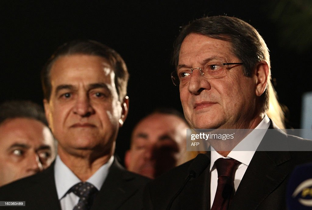 Nikos Anastasiadis (R), one of the two remaining candidates in the Cypriot presidential election, speaks to the press prior to the last televised political debate in Nicosia, on February 22, 2013 ahead of the scheduled elections on February 24. AFP PHOTO / YIANNIS KOURTOGLOU