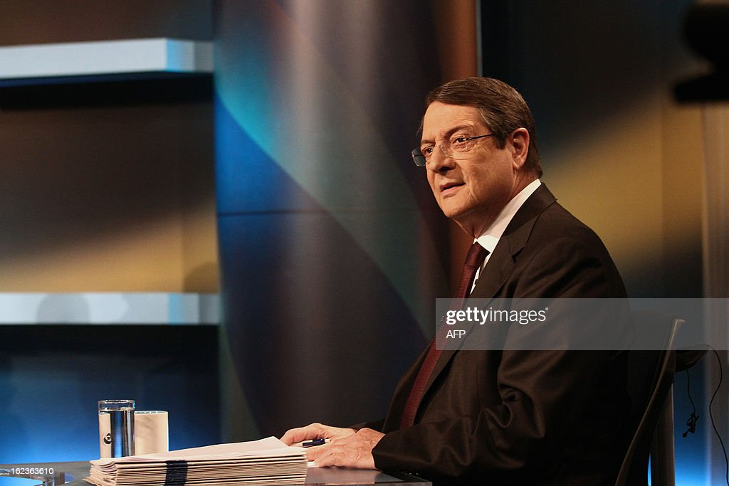 Nikos Anastasiadis, one of the two remaining candidates in the Cypriot presidential election, attends the last televised political debate in Nicosia, on February 22, 2013 ahead of the scheduled elections on February 24. AFP PHOTO / YIANNIS KOURTOGLOU