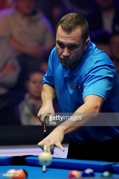 Nikos Ekonomopoulos of Greece plays a shot against Karol Skowerski of Poland during semifinal of Partypoker World Pool Masters 2014 on November 16...