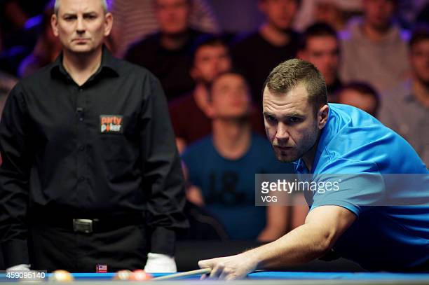 Nikos Ekonomopoulos of Greece plays a shot against Shane Van Boening of USA during the final of 2014 Partypoker World Pool Masters on November 16...