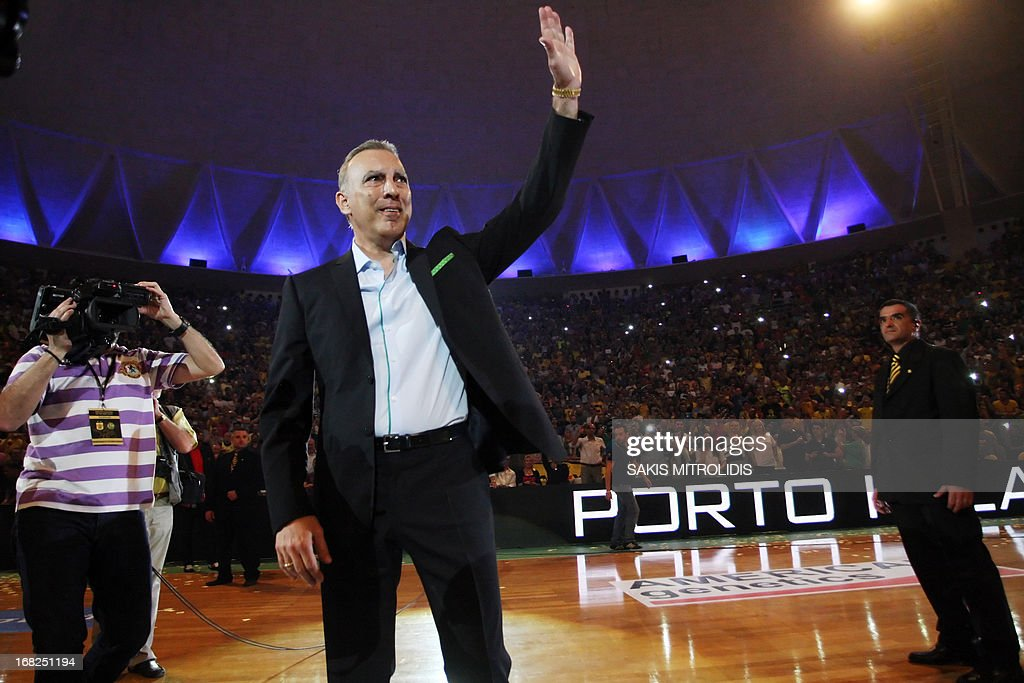 Nikos Galis poses waves at fans during an event at the Alexandrio stadium in Thessaloniki on 7 May, 2013. Nikos Galis, one of the greatest European basketball players, was honored tonight by his club Aris bc. Veteran legends payed tribute to the all-time greatest Greek basketball player during an exhibition match and the event was also an informal reunion of the 1987 national team that won the European Championship. AFP PHOTO /Sakis Mitrolidis