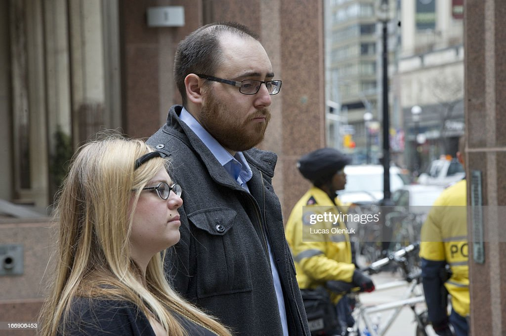 Nikos Kapetaneas and Caitlin Morgan held a news conference in front of Toronto Police Headquarters Thursday monring to announce that they had reached a cash settlement with police after they were assaulted during the G20.