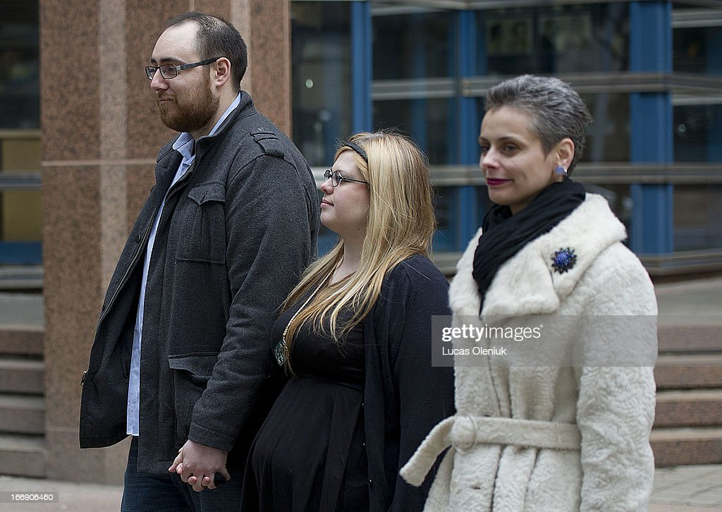 Nikos Kapetaneas,Caitlin Morgan and Anna Grychtchenko (right) held a news conference in front of Toronto Police Headquarters Thursday morning to announce that they had reached a cash settlement with police after they were assaulted by police during the G20.