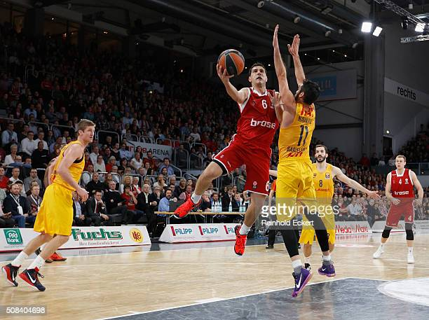 Nikos Zisis #6 of Brose Baskets Bamberg competes with Juan Carlos Navarro #11 of FC Barcelona Lassa during the Turkish Airlines Euroleague Basketball...