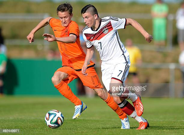 Nikos Zografakis of Germany is challenged by Martijn Kaars of the Netherlands during the international friendly U15 match between Germany and...