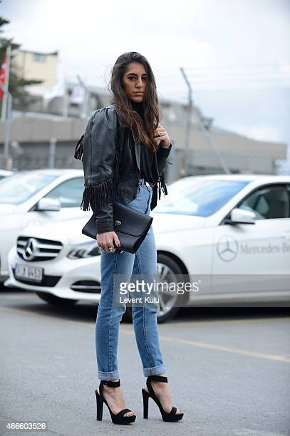 Nil Nihat poses wearing jacket by Yves Saint Laurent jean by Asos shoes by Zara tshirt by Cos and hand bag of her own design by Nill'in during...