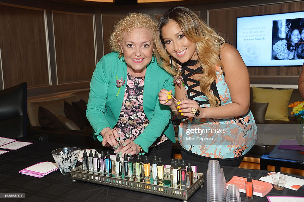 Nilda Bailon (L) and singer <a gi-track='captionPersonalityLinkClicked' href=/galleries/search?phrase=Adrienne+Bailon&family=editorial&specificpeople=540286 ng-click='$event.stopPropagation()'>Adrienne Bailon</a> attend the Shawn Carter Foundation's Mother's Day event 'Celebrating Mothers, Our First Educators' at 40 / 40 Club on May 11, 2013 in New York City.