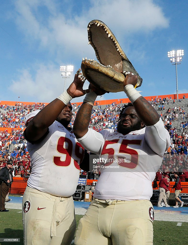 Nile LawrenceStample and Jacobbi McDaniel of the Florida State Seminoles celebrate following their 377 win over the Florida Gators on November 30...