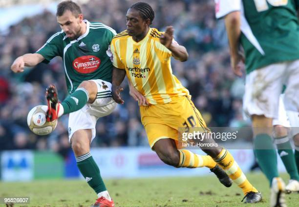 Nile Ranger challenges Carl Fletcher during the third round match of The FA Cup sponsored by EON between Plymouth Argyle and Newcastle United at Home...