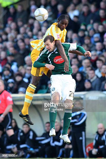 Nile Ranger challenges Luke Summerfield during the third round match of The FA Cup sponsored by EON between Plymouth Argyle and Newcastle United at...