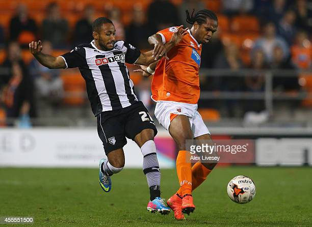 Nile Ranger of Blackpool holds off a challenge from Ikechi Anya of Watford during the Sky Bet Championship match between Blackpool and Watford at...
