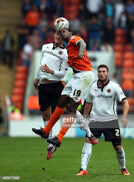 Nile Ranger of Blackpool in action with George Saville of Wolverhampton Wanderers during the Sky Bet Championship match between Blackpool and...