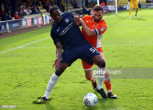 Nile Ranger of Southend United holds of Blackpool's Jimmy Ryan during Sky Bet League one match between Southend United against Blackpool at Roots...