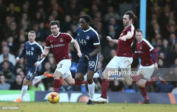 Nile Ranger of Southend United moves with the ball between David Buchanan and JohnJoe O'Toole of Northampton Town during the Sky Bet League One match...