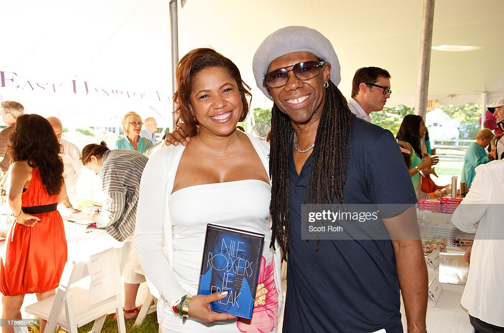 <a gi-track='captionPersonalityLinkClicked' href=/galleries/search?phrase=Nile+Rodgers&family=editorial&specificpeople=217582 ng-click='$event.stopPropagation()'>Nile Rodgers</a> and a fan attend the 9th Annual Authors Night at The East Hampton Library on August 10, 2013 in East Hampton, New York.