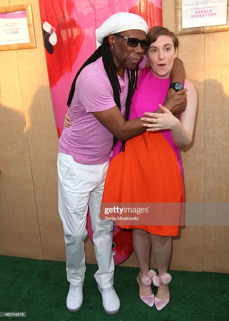 Nile Rodgers and Lena Dunham attend the Hamptons Paddle and Party for Pink-Sunset Cocktail Party Benefiting the Breast Cancer Research Foundation on August 1, 2015 in Bridgehampton, New York.