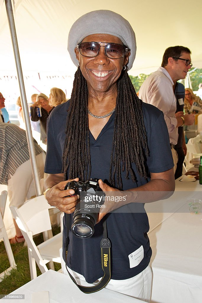 <a gi-track='captionPersonalityLinkClicked' href=/galleries/search?phrase=Nile+Rodgers&family=editorial&specificpeople=217582 ng-click='$event.stopPropagation()'>Nile Rodgers</a> attends 9th Annual Authors Night at The East Hampton Library on August 10, 2013 in East Hampton, New York.