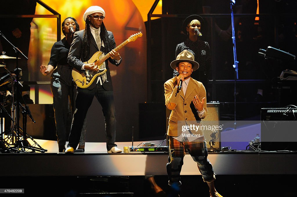 Nile Rogers and <a gi-track='captionPersonalityLinkClicked' href=/galleries/search?phrase=Pharrell+Williams&family=editorial&specificpeople=161396 ng-click='$event.stopPropagation()'>Pharrell Williams</a> perform at The BRIT Awards 2014 at 02 Arena on February 19, 2014 in London, England.