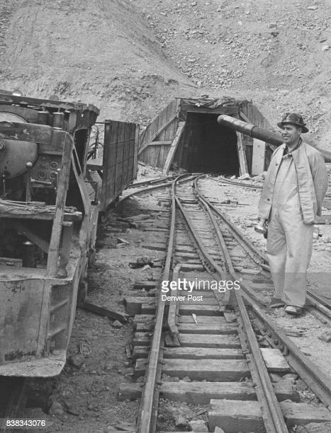 Niles E Grosvenor assistant professor of mining engineering at Colorado School of Mines stands outside the east portal of the pioneer bore100 feet...