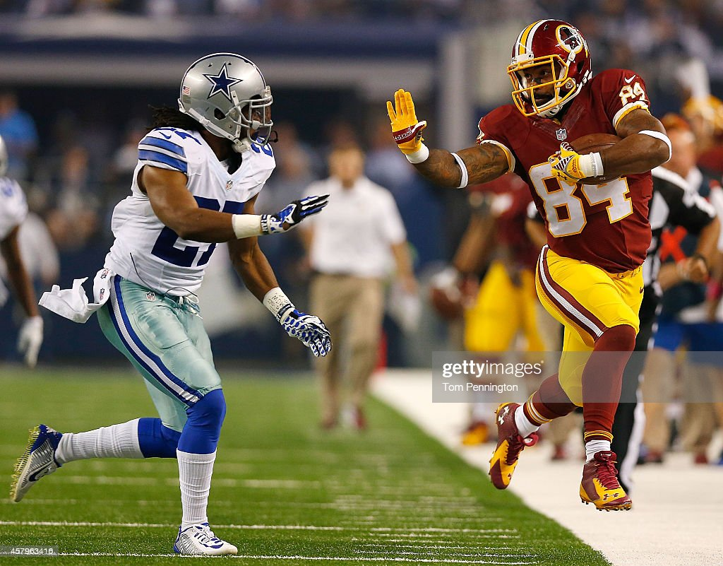 fec7c0598bea ... Niles Paul 84 of the Washington Redskins is forced out of bounds by  J.J. Wilcox ...
