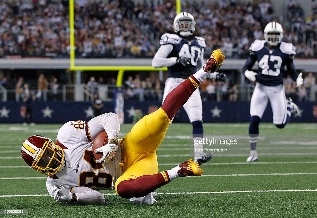 Niles Paul #84 of the Washington Redskins scores a touchdown against the Dallas Cowboys on Thanksgiving Day at Cowboys Stadium on November 22, 2012 in Arlington, Texas. The Washington Redskins beat the Dallas Cowboys 38-31.