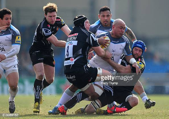 Nili Latu of Newcastle Falcons is tackled by Thomas Waldrom of Exeter Chiefs and Julian Salvi of Exeter Chiefs during the Aviva Premiership match...