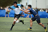 Nili Moala of College TEC is tackled by Tana Fotofili of College Rifles during the match between College Rifles and Grammar TEC at College Rifles on...
