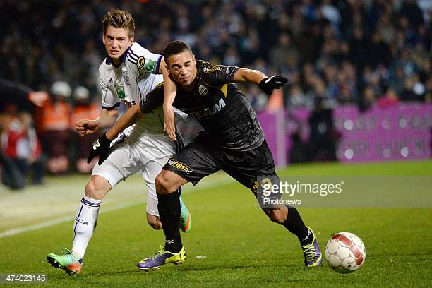Nill De Pauw of KSC Lokeren challenges Dennis Praet of RSC Anderlecht during the Jupiler League match between Sporting Club Lokeren OostVlaanderen...