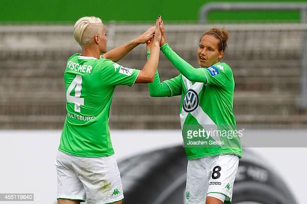 Nilla Fischer and Babett Peter of Wolfsburg celebrate during the Allianz Women's Bundesliga match between VfL Wolfsburg and SC Freiburg on August 30...