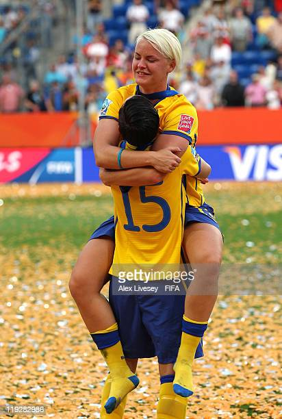 Nilla Fischer and Therese Sjogran of Sweden celebrate after victory over France in the FIFA Women's World Cup 3rd Place Playoff between Sweden and...