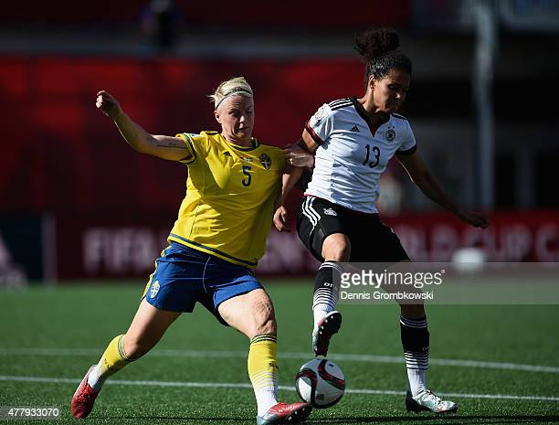 Nilla Fischer of Sweden and Celia Sasic of Germany battle for the ball during the FIFA Women's World Cup Canada 2015 Round of 16 match between...