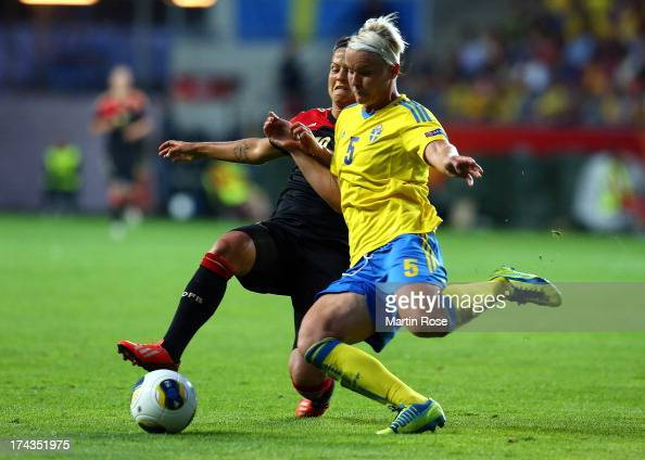 Nilla Fischer of Sweden and Dzsenifer Marozsan of Germany battle for the ball during the UEFA Women's Euro 2013 semi final match between Sweden and...